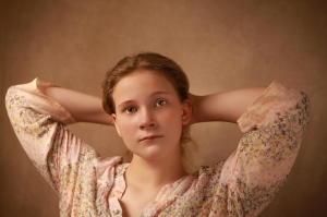 a fine art portrait of a young woman posing